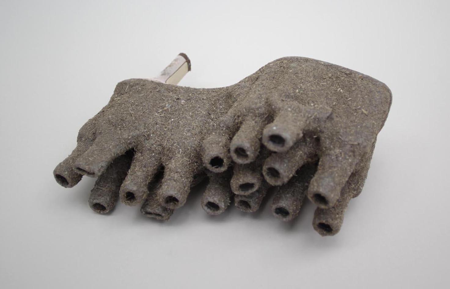 <b>sole II</b><br> found shoe, plastic bottles. feeds, glue 2014, 4 x 9 x 7 inches