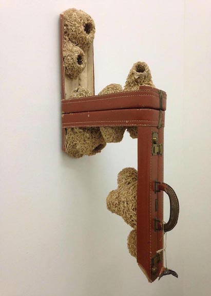 <b>suitcase colony v </b><br> found vintage suitcase, suitcase pieces, glue 2013, 35 x 14 x 7 inches